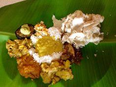 INDIAN food on Divali today . All vegetarian food on a banana leaf . Happy Divali