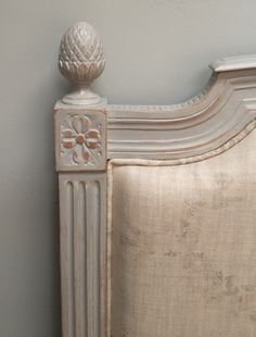 Lovely detail of an upholstered French bed