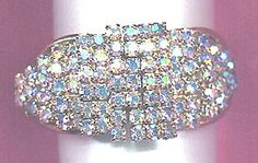 AB rhinestone hinged bangle Oh, the rhinestones! Crystal aurora borealis prong set beauties flash and shimmer, pink, purple blue and yellow, and reflects nearby colors.