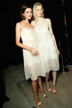 A pair of sheer, wispy dresses, backstage at Narciso Rodriguez.
