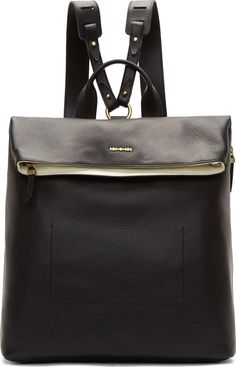"""Pebbled leather backpack in black. Brass-tone hardware. Carry handle at top of bag. Adjustable shoulder straps. Foldover flap with magnetic press-stud closure. Signature razor blade accent at flap face. Zip pocket at side. Zip closure at bag throat. Zip and patch pockets at bag interior. Textile lining. Tonal stitching. Approx. 14"""" length x 15"""" height x 6.5"""" width."""