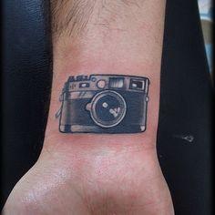 Small Camera Tattoo On Wrist photo - 3                              …