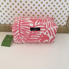 Kate Spade Medium Davie in Pink and White Vinyl Kate Spade Grant Street Grainy Vinyl Medium Davie Cosmetic Bag! This is new with tags and the vinyl makes it a great makeup bag since the outside is so easy to clean! kate spade Bags Cosmetic Bags & Cases