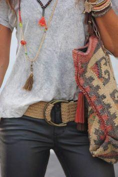 Layered necklaces & bracelets. Casual t & aztec print purse.
