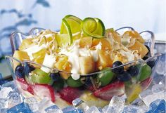 layered yogurt fruit salad ♥  1 container (6 ounces) Yoplait Thick & Creamy Key lime pie yogurt  2 tablespoons orange juice  2 cups fresh pineapple chunks  1 cup strawberry halves  2 cups green grapes  1 cup blueberries  2 cups cubed cantaloupe  1/4 cup flaked or shredded coconut, toasted
