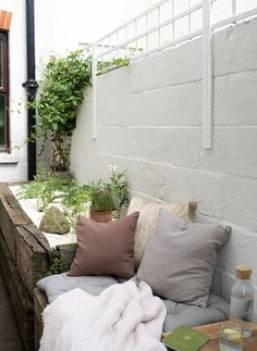 A modern-rustic small backyard dry garden styled with a linen cushions, braided jute cushions and French style mattress - how to plant a dry garden in a raised bed - linen cushions in an outdoor living space - Chalk Hill, Dry Garden, Garden Nursery, Hardy Perennials, Outdoor Seating Areas, White Doves, Raised Bed, Shade Garden, Garden Styles