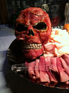 Meat head. Use lunch meat to cover a plastic skull held on with BBQ sauce. Happy Halloween!