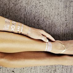 Temporary jewelry tatoos.... So cool for the beach. No more loosing anklets!!