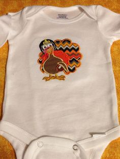 Bella 6 Designs, Fall Football Turkey /chevron onsie. Fall Holiday Embroidery / Appliqué  $25.00 USD + shipping 803-487-8570 http://bella-6-designs.myshopify.com