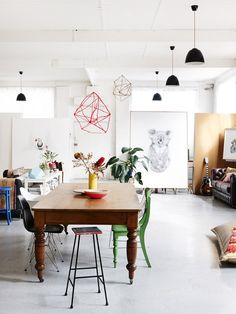 Wire sculptures hung over the dining table. Melbourne Home · C...