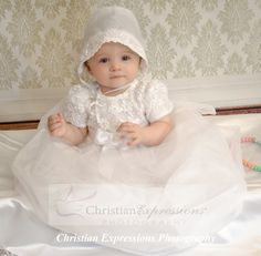 This adorable christening gown is embroidered with satin ribbon bodice and tulle skirt. Matching bonnet includes. Quality made in the USA