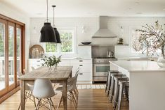 """Kitchen, dining. My absolute favourite, though probably not quite in the style of """"Modern Australian with some earthiness.""""  Silver, white and wood, with the tiniest bit of black."""