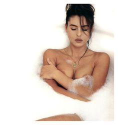 Monica Bellucci the definition of perfection...not young, curvy, dark, beautiful face, mysterious, open-minded, stylish.