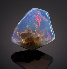 It's currently on auction at Bonhams. | This Beautiful Gemstone Looks Like It Contains A Small Nebula