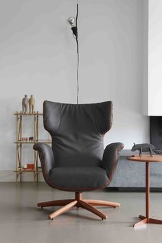 First Class Arm Chair in Grey leather with orange zippers (design by Gerard van den Berg)