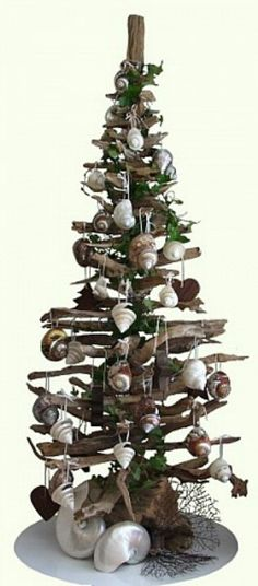 A contemporary alternative Christmas tree idea: Driftwood with Sea Shell ornaments - cute! Nautical Christmas, Beach Christmas, Noel Christmas, All Things Christmas, Winter Christmas, Christmas Crafts, Christmas Decorations, Christmas Ornaments, Driftwood Crafts