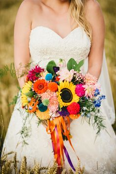 Bouquet Flowers Rainbow Pom Poms Ribbons Bride Bridal Sunflowers Gerbera Dahlia All Things Big Bright Beautiful Multicolour Wedding http://benjaminmathers.co.uk/