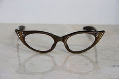 f1fe166ebc44 Items similar to VINTAGE 1960 s Women s New Old Stock Iridescent Brown  Jeweled Cat Eye Glasses Frame France on Etsy