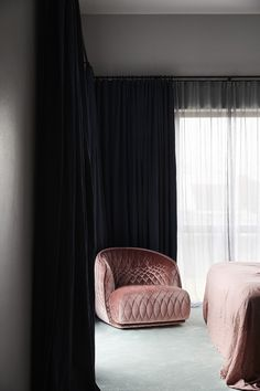 bedroom with pink armchair