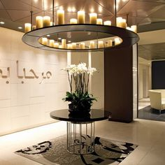 Qatar Airways will open its first airport lounge outside Doha at London Heathrow. Ceiling Chandelier, Ceiling Lights, Airport Lounge, Linear Lighting, Commercial Design, Beautiful Interiors, Innovation Design, A Boutique, Decoration