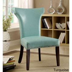 The Flarisa Dining Chairs (Set of 2) are elegantly and eye-catching with arching wingback design and framing nail head trim. Faux leather upholstery adds a smooth touch while cushioned seats ensures l