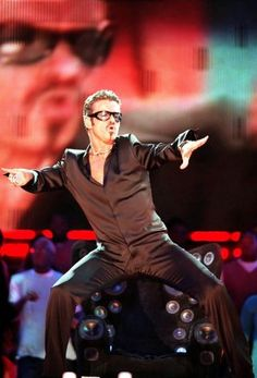 Pop star George Michael performs live on stage at netAID held at Wembley Stadium, London on October 9 1999. Photo: Dave Hogan / Getty Images