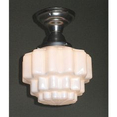 Puffy milk glass shade on brushed nickel fitter for bedroom or bathroom.