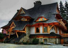Another pinner:I don't know about you but this wonderful roof immediately evokes remembrances of fairy-tales. The home is in Zakopane Poland. This is just one example of the amazing houses and buildings we have in our collection. You can view the full album on our site at http://theownerbuildernetwork.co/house-hunting/amazing-homes-and-buildings/ Don't forget to share your thoughts in the comments section.