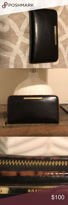 Brahmin zip around wallet Black leather with animal trim  zip around wallet good condition now tears or marks in the leather brahmin Accessories
