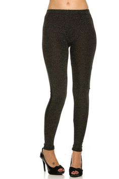 90%Poly, 10%Spandex. Made in CHINA These unique and trendy leggings feature an elasticized waistband, slim stretch fit, metallic knit front, and a contrast back vegan leatherette material. Get an edgy look in our Metallic