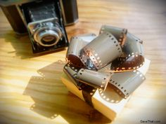 How to make your own gift bows out of camera film OR washi paper tape wrapping paper old newspaper comics or recycled magazine pages