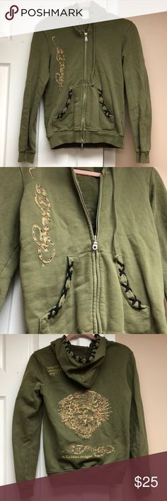 """Ed Hardy Green Sweatshirt Size Medium Women's Ed Hardy green sweatshirt in a size medium! This sweatshirt is used but is in great condition! There is no pilling & no signs of wear. The sweatshirt features a hood & two front pockets, both with a really cool black cross-stitch trim. A leopard pattern is featured on the """"Ed Hardy"""" on the front & tiger on the back of the sweatshirt. The zipper is a dual zipper (see 1st pic- there is a zipper at the top & bottom of the sweatshirt) & is fully…"""