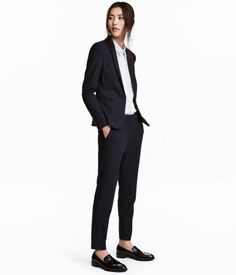 Dark blue/chalkstripe. Suit pants in woven fabric with a tapered fit. Side pockets, welt back pockets, zip fly, and concealed hook-and-eye fastener. Creases