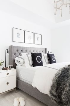 Black and white interiors can elicit mixed reactions. Some think they are boring and look like hospital rooms, while others find their Scandinavian minimalism calming and chic. Personally, I love the classically minimal home of Stephanie Sterjovski's dreamy black and white space below. The crisp contrast of black and white with grey mixed in (like this grey tufted wingback headboard!) is so refreshing!