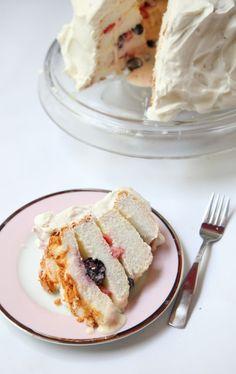 angel food cake with lemon curd, fresh whipped cream, and drunken berries