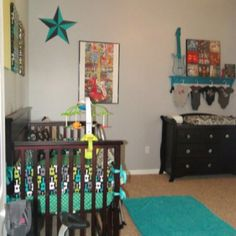 Brady's Rockstar Nursery     *************************************************************  Crib bedding from etsy.com, birdshaveflowers, link is below.   Framed guitar print is from hobby lobby.     Punk star is from hobby lobby, it was red, I taped it off and painted it to match his room colors.  Turquoise shag rug is from walmart.   Fabric covered canvases on wall I made, they are with Michael Miller fabric and Henry Alexander.