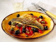 Lubina a la sartén con aceitunas, piquillos y fino. (Pan-fried sea bass with Spanish olives, piquillo peppers and dry Sherry)