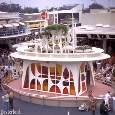 "At Disneyland, Coca-Cola Tomorrowland Terrace and its amazing bandshell debuted as part of the 1967 ""New Tomorrowland."" The space-age bandshell ascended to reveal bands and descended to turn back into a stylish planter with fresh flowers growing from huge bowls."