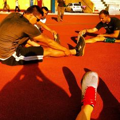 Streching after the workout at Grava's track.