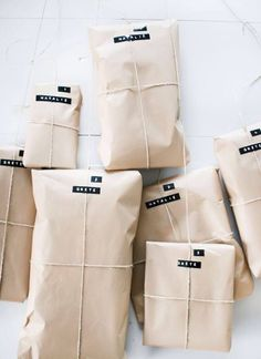 simple gift wrapping with kraft paper, twine and tags printed with a labeler Wrapping Gift, Creative Gift Wrapping, Wrapping Ideas, Creative Gifts, Paper Packaging, Pretty Packaging, Gift Packaging, Simple Packaging, Packaging Ideas