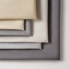 Carreaux is a panel and wrapped wall fabric with an elegant, refined look. It features a complex yarn that was created specifically for this pattern. It's a combination of four different fibers, each of which responds to a different type of dye. This allows us to create very subtle tonal variations within this fine yarn. The six warm and cool neutrals are designed to be used in serene, tranquil spaces. Collections