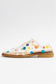 Designers seem to be favoring clear shoes for the Spring 2013 season...