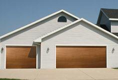 Fiberglass Garage Door Model 984 | Impression Collection® | This garage door features a horizontal V-groove design with an oak wood grain pattern. | Learn more at overheaddoor.com