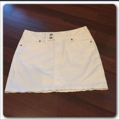 White Jean stretch skirt Snow White stretch skirt.  14 inches long.  14 inches across waist when laying flat.  Snap pockets on back. GAP Skirts