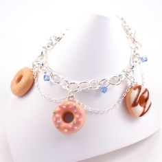 Scented Donuts Bracelet handmade from polymer clay. Super cute miniature donuts and Swarovski crystals adorn this scented bracelet. Made by Tiny Hands.