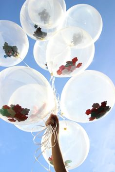 Fill clear balloons with all sorts of things to match your party theme