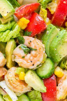 Avocado Shrimp Salad Recipe with cajun shrimp and the best flavors of summer. The cilantro lemon dressing gives this shrimp salad incredible fresh flavor! | natashaskitchen.com