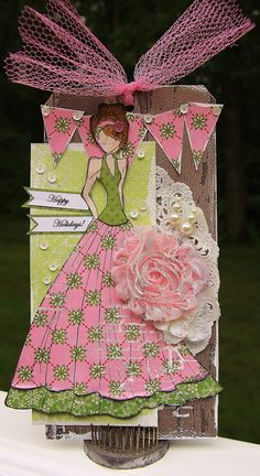 """A tag using Julie Nutting's new mixed media Doll Stamp. This is """"Lorrena"""" the largest of the new stamps and she is for a Christmas in July project at my LSS."""