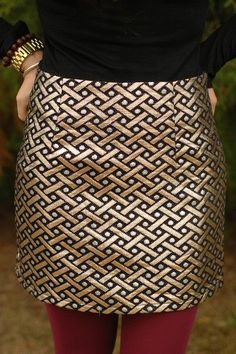 Beautiful gold skirt. This would go with pretty much anything! I'd love to see this with a green or red blouse.