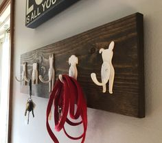 Here's a dog leash holder where the hooks are the tails of the dogs.